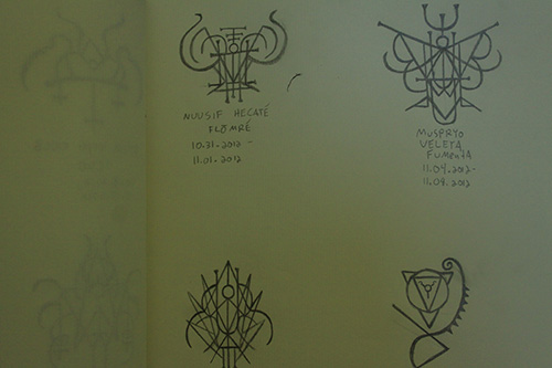 Sigils in sketchbook.
